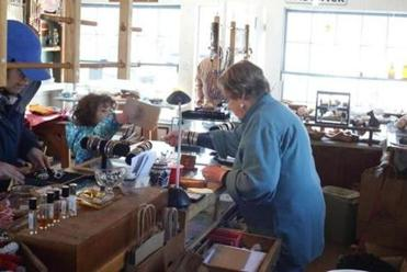 The Scituate gift shop's owner, Joan Noble, served a young customer (below) as she prepared to close its doors this Saturday.
